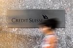 A pedestrian walks past the Credit Suisse Group AG headquarters in New York, U.S.