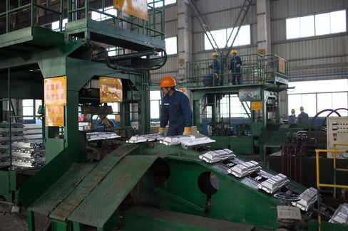 Aluminum ingots are produced at an aluminum smelting factory in Zouping, China, on Nov. 4, 2013.