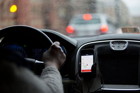 The Uber Technologies Inc. application runs on an Apple Inc. iPhone during an Uber ride in Washington, D.C., on April 8, 2015.