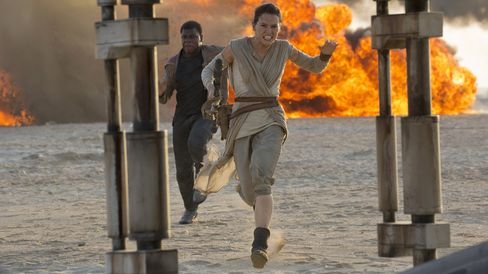 John Boyega as Finn and Daisy Ridley as Rey