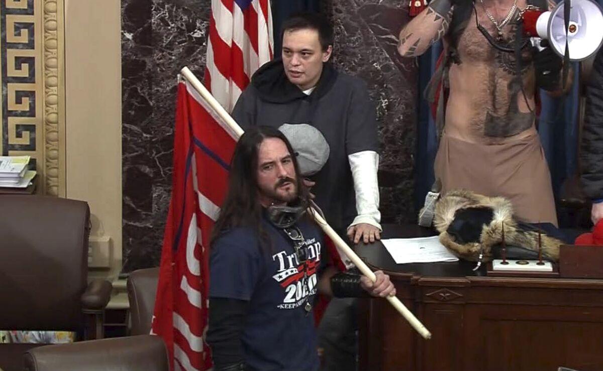 Trump Flag Bearer Gets First Capitol Riot Prison Sentence