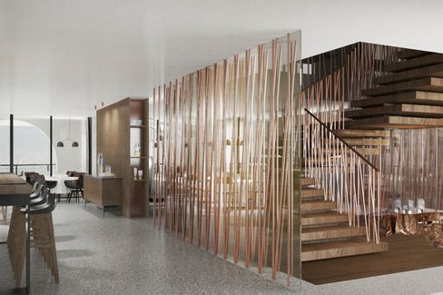 The floating, copper-encased stairwell in the lobby.