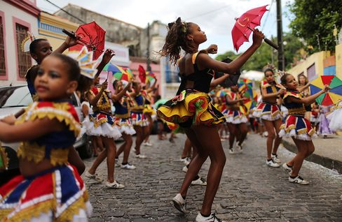 Revelers dance during pre-Carnival celebrations in Recife, Brazil.