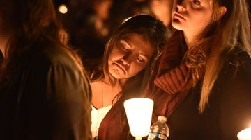 A student mourns during a vigil in Roseburg, Oregon, on Oct. 1, 2015.