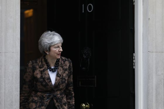 May Won't Rule Out Brexit Delay as U.K. Parliament Takes Control