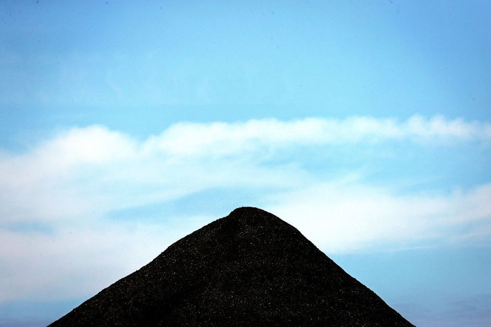 China's blocking Australian coal, not iron ore.