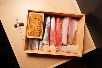 Shuko's neta, or carefully cut filets of fish, are ready to be sliced for individual pieces.