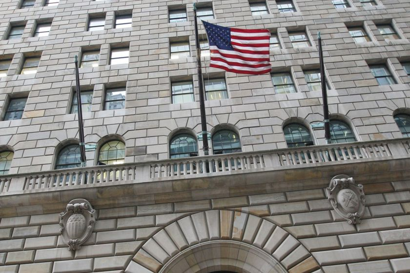 The U.S. flag hangs on the facade of the Federal Reserve Ban
