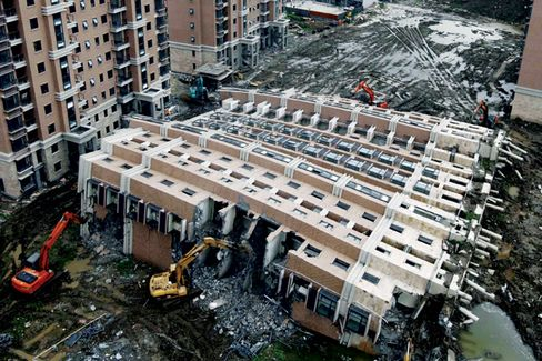 The Cracks in China's Shiny Buildings