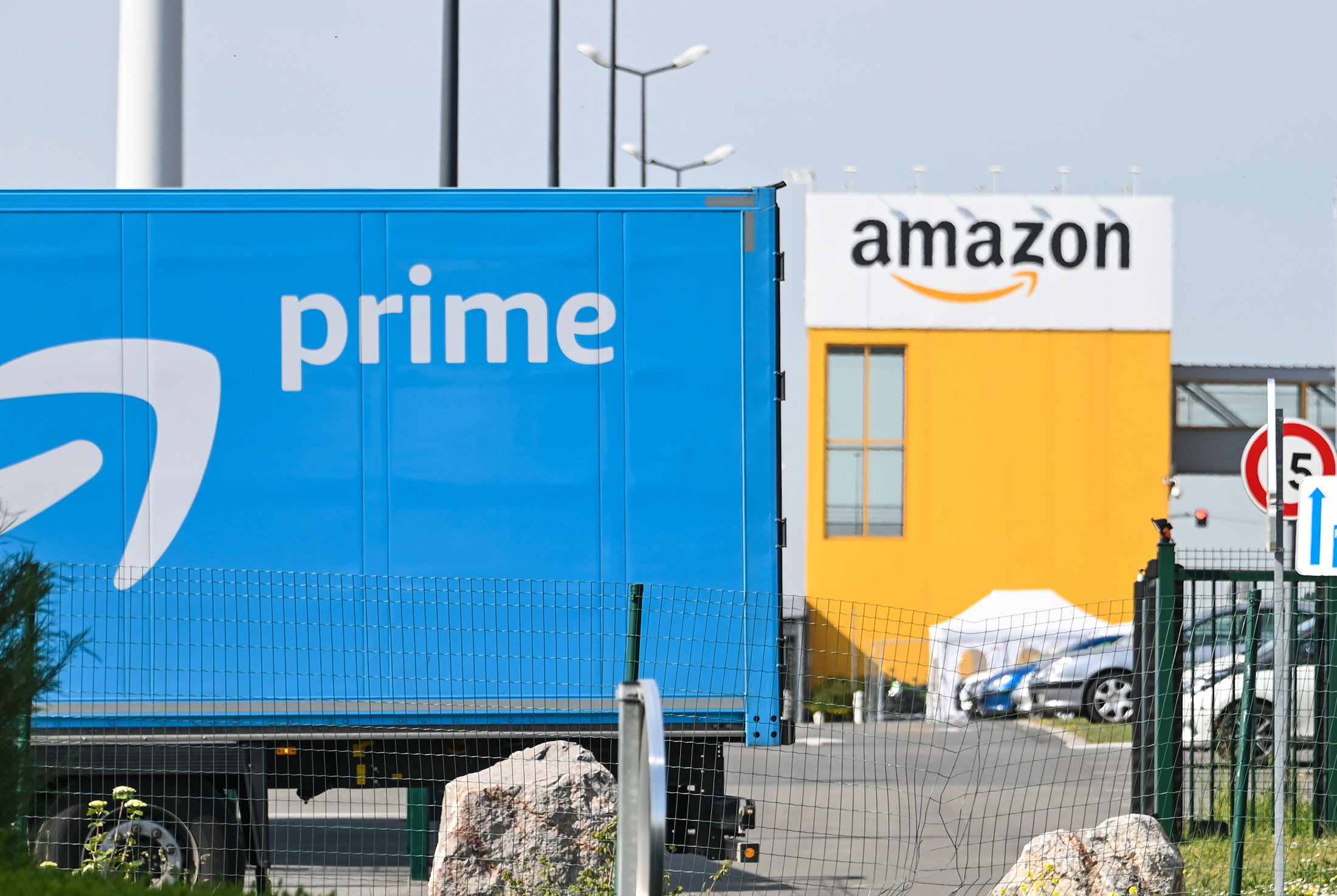 An Amazon delivery lorry is parked outside the Amazon logistics centre in Lauwin-Planque, France, on April 16.