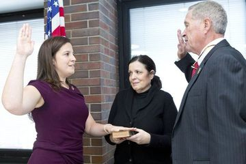 Jan Plumadore, retired New York State Supreme Court Justice, administers the oath of office to Congresswoman Elise Stefanik, while her mother, Melanie Stefanik, holds the Bible, during a ceremonial swearing-in ceremony in the legislative chambers at the Clinton County Government Center in Plattsburgh Saturday afternoon.