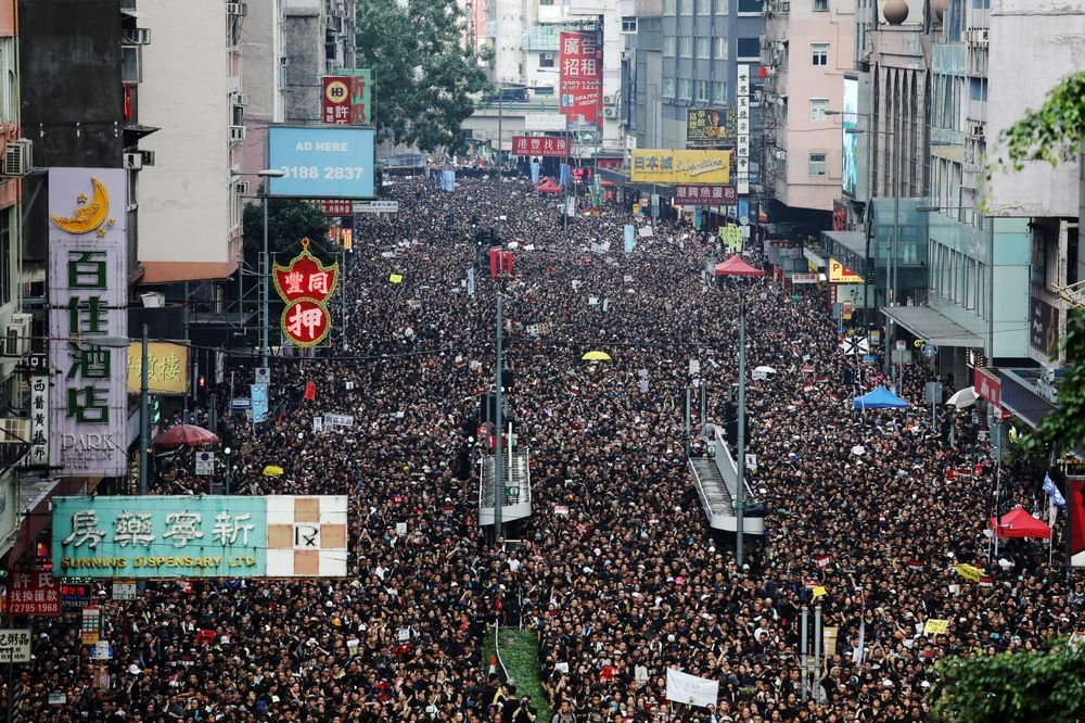 Hong Kong's Leader Apologizes as Hundreds of Thousands Call for Her Resignation
