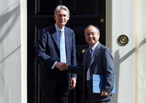 Philip Hammond and Masayoshi Son in London on July 18.