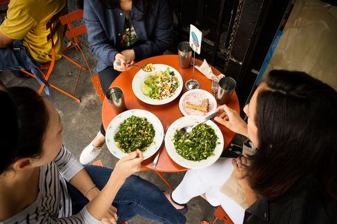 Diners sit outside to enjoy the fresh, tangy, tasty fare at Sqirl.