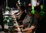 Attendees play online video games in the Samsung Japan Corp. and Nexon Co. collaboration booth at the Tokyo Game Show 2017 at Makuhari Messe in Chiba, Japan, on Friday, Sept. 22, 2017. The game show runs through Sept. 24.