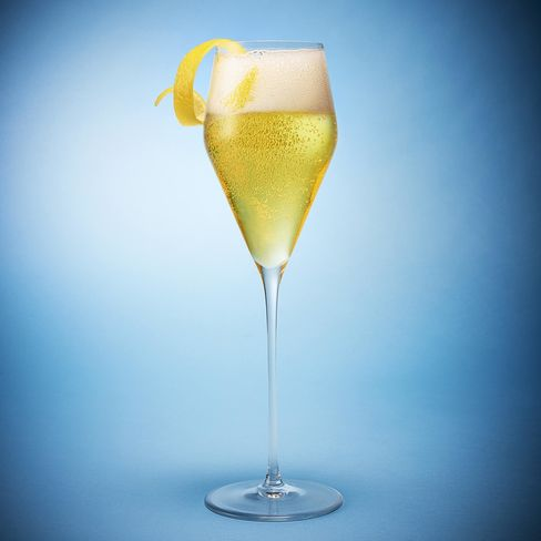 1468005261_perfect-champagne-cocktail-french-75-pursuits-bloomberg-lede