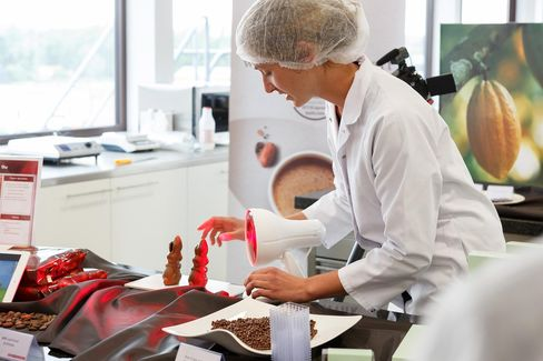 Food scientists demonstrate their heat-resistant chocolate at the Barry Callebaut AG's R&D Center. Source: Barry Callebaut AG