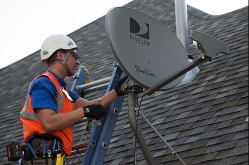 A DirecTV Employee Performs a Satellite Installation