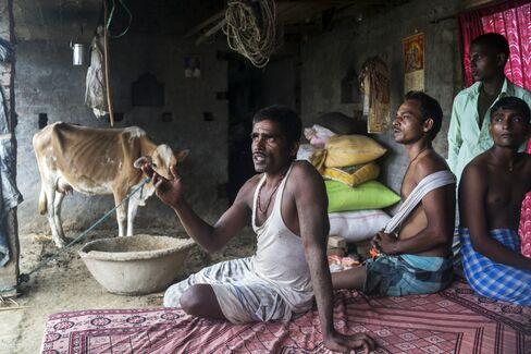 Farmer Nishibi Rai, center. Photographer: Prashanth Vishwanathan/Bloomberg