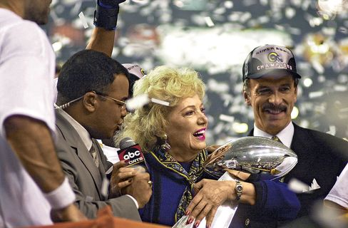 Kroenke with St. Louis Rams owner Georgia Frontiere after the team won the Super Bowl in 2000.