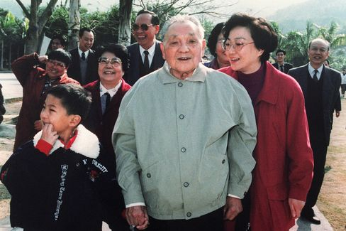 Deng Xiaoping takes a walk in January 1992 surrounded by his daughters and grandson during his visit to Shenzhen, one of five favoured Special Economic Zones in China.