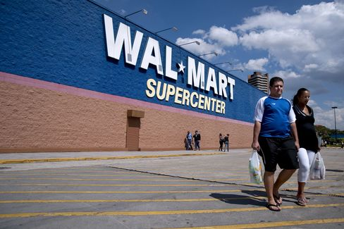 Shoppers Leave a Wal-Mart Supercenter Store in Sao Paulo