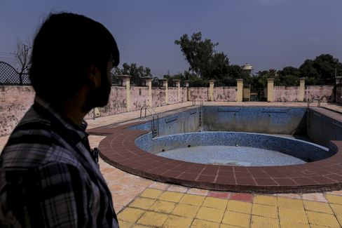 The swimming pool sits empty at the old British Gymkhana Club in Mughalsarai, which is now used by Indian Railways officers.