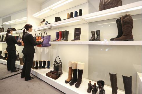 A Shop Assistant Adjusts a Handbag Display in a Store in Davos