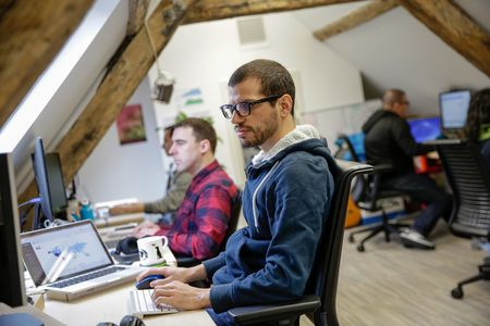 Melvin Salas, co-founder of Leaf.fm, works at his desk in the Leaf.fm headquarters in Newcastle upon Tyne.