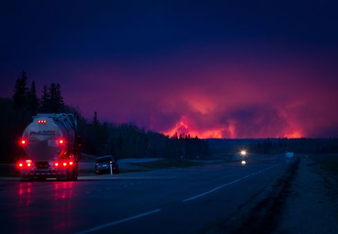 Wildfire burns south of Fort McMurray, Alberta on Wednesday.