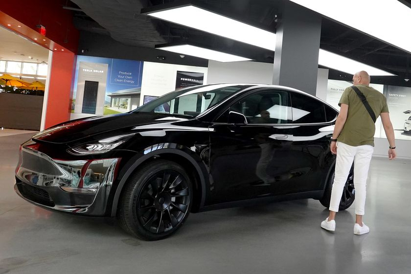 Electric Car Maker Tesla Reports Record Quarterly Earnings