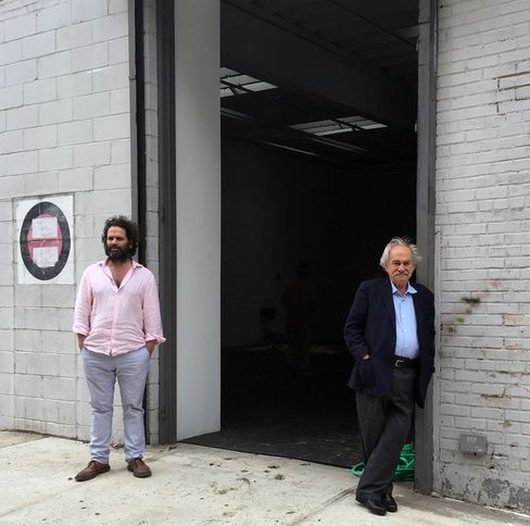 Gallery owner Gavin Brown and artist Jannis Kounellis outside the NYC installation of Untitled (12 Horses).