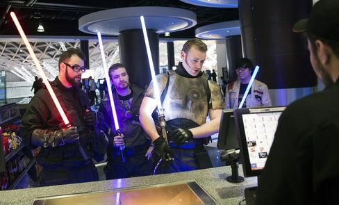 Star Wars fans collect their tickets