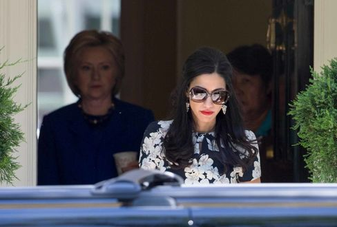 Huma Abedin and Hillary Clinton.