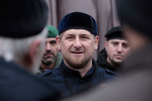 Chechen President Ramzan Kadyrov, center, speaks to Chechen top commanders while inspecting Chechen special forces in Grozny, Russia, on Dec. 28, 2014.