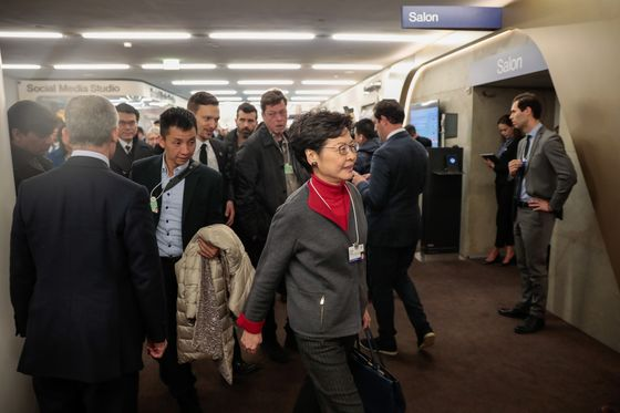 Carrie Lam Courts Davos Elites With Dim Sum to Sell Hong Kong