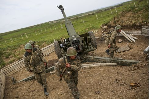 Nagorno-Karabakh army artillerymen prepare to open fire from a howitzer on Tuesday.