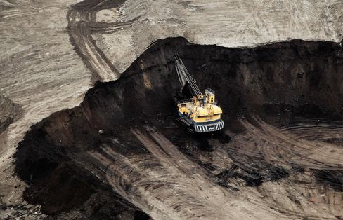 Oil sands mining operation near Fort McMurray, Alberta, Canada.