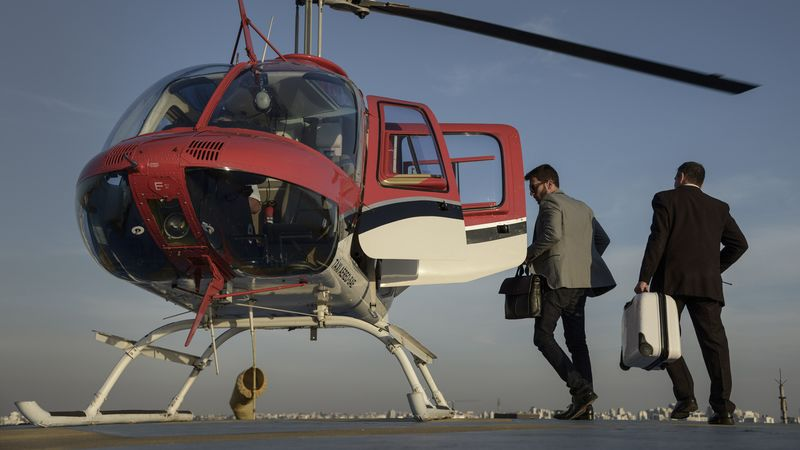 A Passenger Prepares To Board An UberCopter