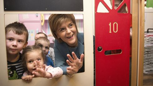 Nicola Sturgeon, leader of the Scottish National Party, meets children as she campaigns ahead of the May 7 general election, in Livingston, U.K., on May 5, 2015. Photographer: Simon Daswson/Bloomberg