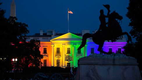 The White House stands illuminated in rainbow-colored light at dusk in Washington on Friday.