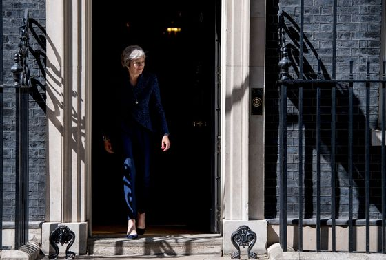 May Averts Brexit Revolt But Her Rivals Also Claim Victory