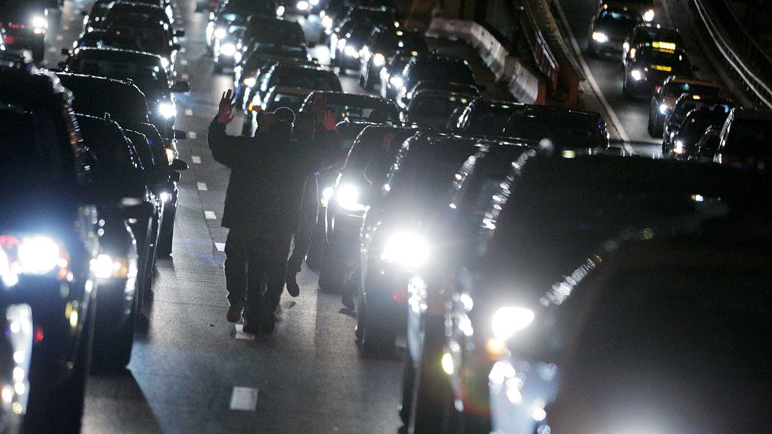 Demonstrators walk in traffic on Highway I-395 during a protest following the grand jury's decision on Dec. 3, 2014, in Washington, D.C.