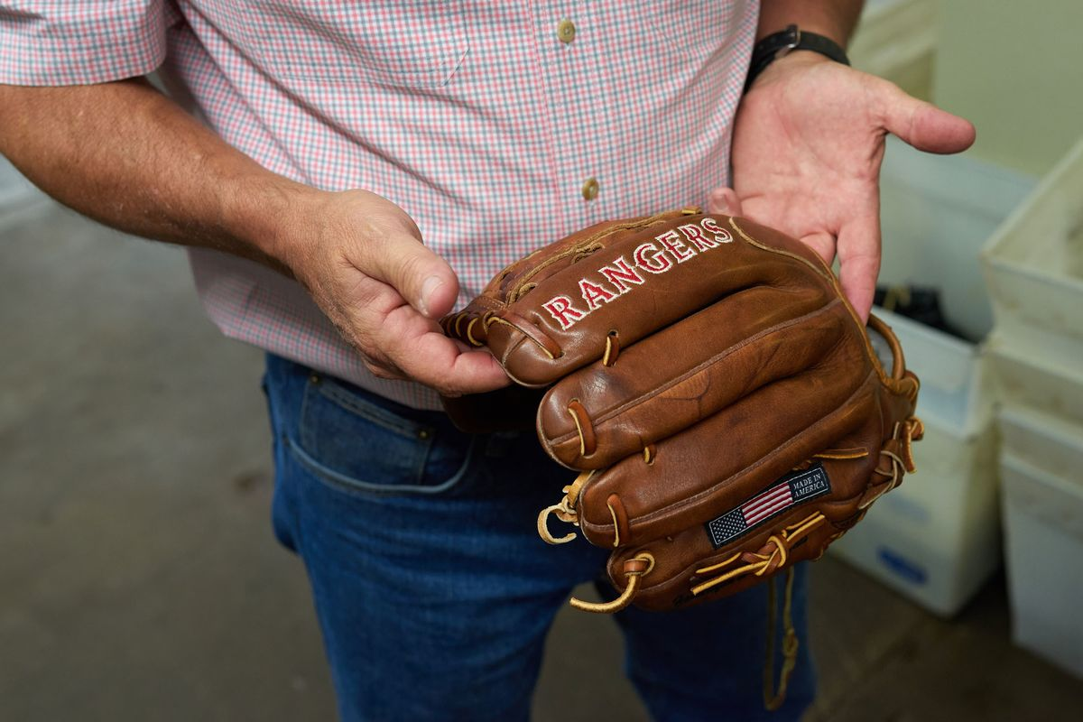 6efb86b01a3 Rob Storey holds a glove made for the Texas Rangers at the Nokona  manufacturing facility in Nocona
