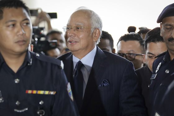 Najib Faces Bribery Charges Linked to 1MDB Bond, M&A Deals