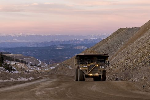 AngloGold Reports Loss and Suspends Dividend as Bullion Tumbles