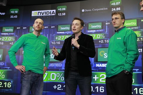 Peter Rive, Elon Musk, and Lyndon Rive speak at the December 2012 IPO of SolarCity.