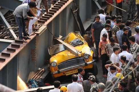 A taxi cab crushed by the collapsed bridge on March 31. 2016 in Kolkata, India.
