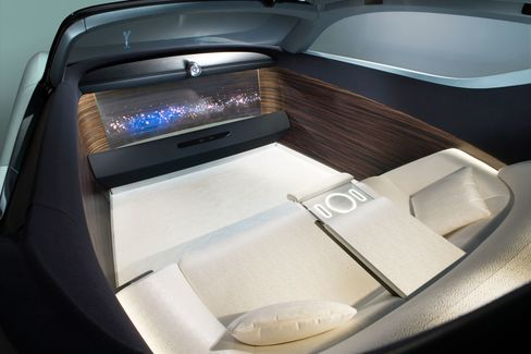 The car contains a silk-swathed sofa for passengers and is lined in wood.