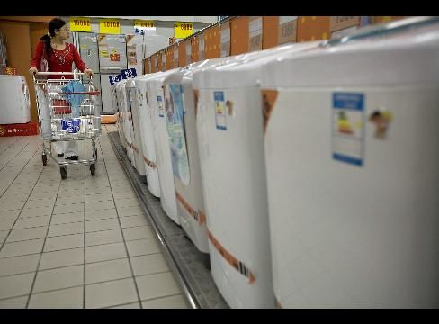 A shopper browses Haier washing machines